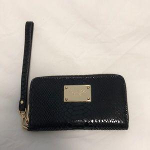 michael kors wristlet wallet in black and gold